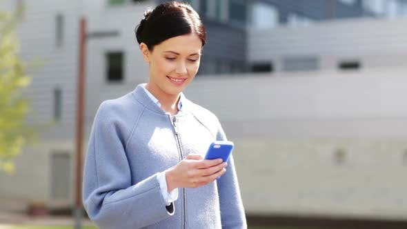 Thumbnail for Smiling Businesswoman With Smartphone Texting