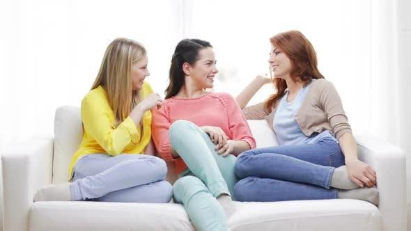 Three Smiling Girlfriends Having A Talk At Home 1