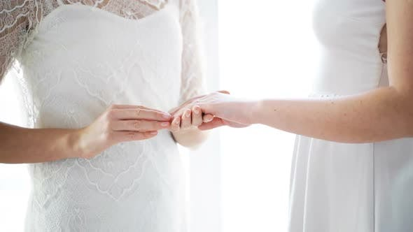 Thumbnail for Close Up Of Lesbian Couple Hands With Wedding Ring 6