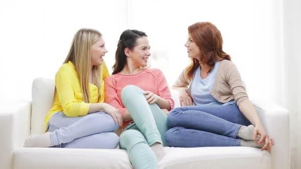 Thumbnail for Three Smiling Girlfriends Having A Talk At Home 2
