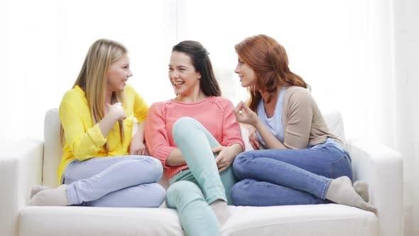 Three Smiling Girlfriends Having A Talk At Home 3