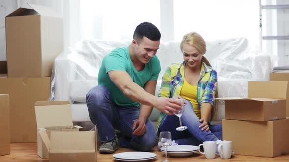 Thumbnail for Smiling Couple Unpacking Boxes With Kitchenware 4