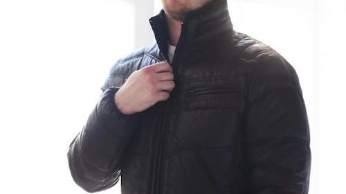 Close Up Of Man Unzipping His Black Jacket At Home 1
