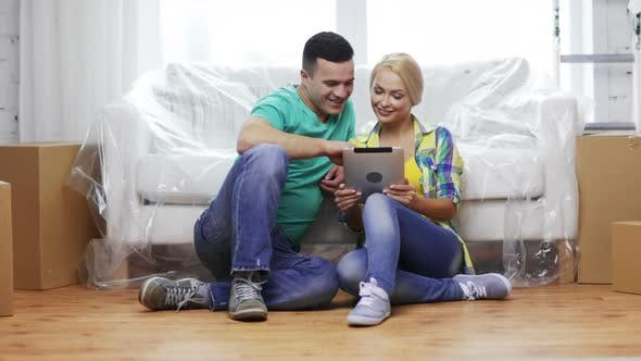 Thumbnail for Smiling Couple With Tablet Pc In New Home 1