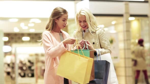 Thumbnail for Happy Young Women With Shopping Bags In Mall 2