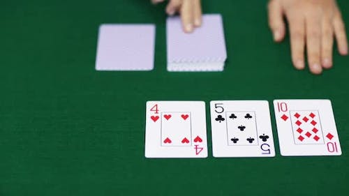Holdem Poker Dealer With Playing Cards 5