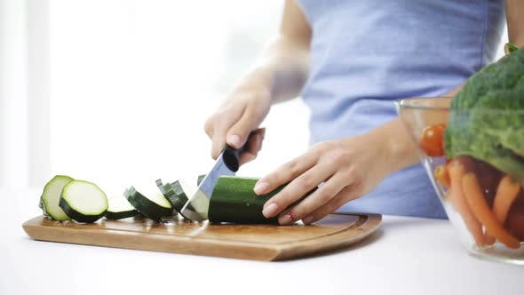 Thumbnail for Close Up Of Young Woman Chopping Squash At Home 3