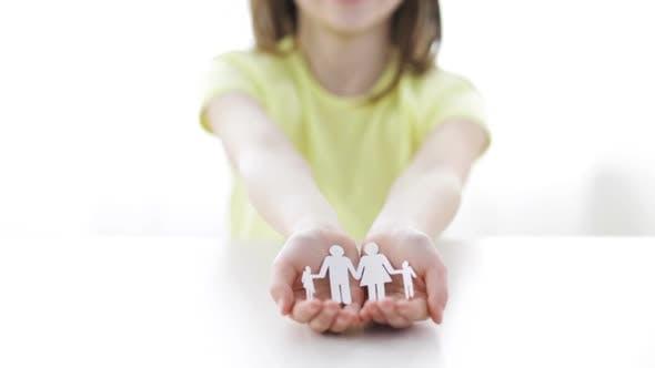 Thumbnail for Smiling Little Girl Showing Paper Man Family