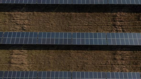 Thumbnail for AERIAL: Overhead Drone View of Solar Panels That Produce Green, Environmentally Friendly Energy From
