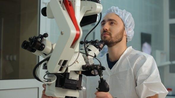 Thumbnail for Bearded Man Loking At Monitor At Big Microscope