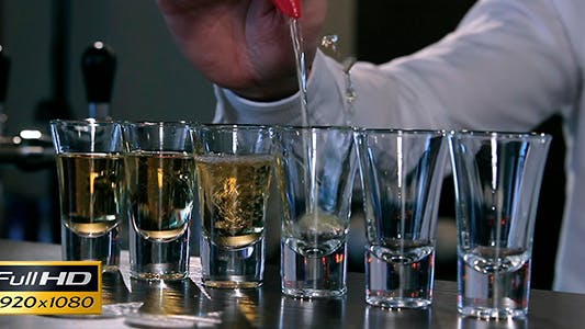 The Bartender Pours Alcohol