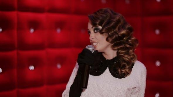 Thumbnail for Elegant Girl With a Microphone Singing Karaoke Bar