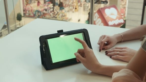 Thumbnail for Two Girls Show The Tablet With The Green Screen