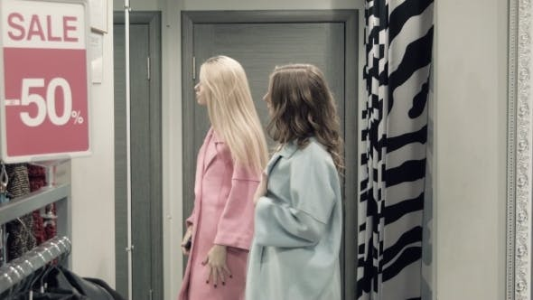 Thumbnail for Two Girls Try On a Coat In a Locker Room