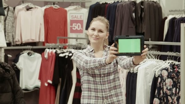 Thumbnail for The Seller Shows The Tablet With The Green Screen