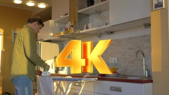 Thumbnail for Adult Man Ironing White Shirt In The Kitchen