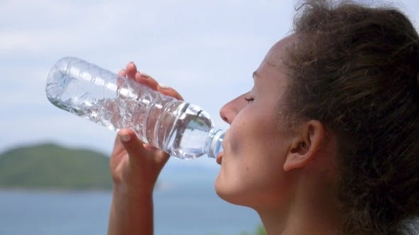Thumbnail for Woman Drinking Water From Bottle