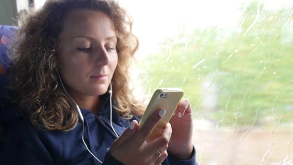Thumbnail for Female Passenger Listening To Music In Phone
