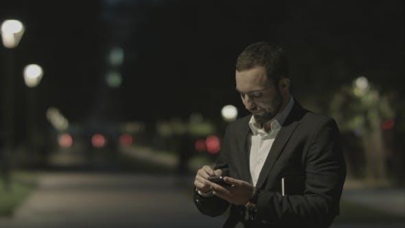 Thumbnail for Displeased Bearded Businessman Use Smart Phone