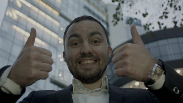 Thumbnail for Two Thumbs Up, Portrait Of Young Business Man On