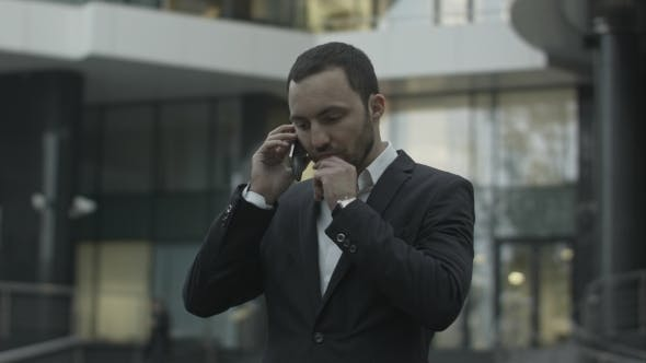 Thumbnail for Displeased Business Man Seriously Talking By Phone