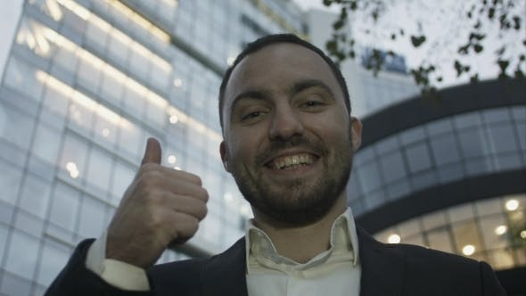 Thumbnail for Portrait Of Young Business Man With Beard Smiling