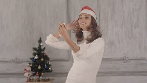 Thumbnail for Cute Woman Making Selfie In Christmas Hat.