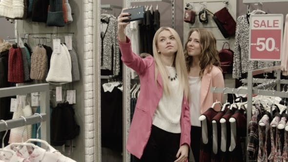 Thumbnail for Girlfriends Do The Selfie In Clothing Store
