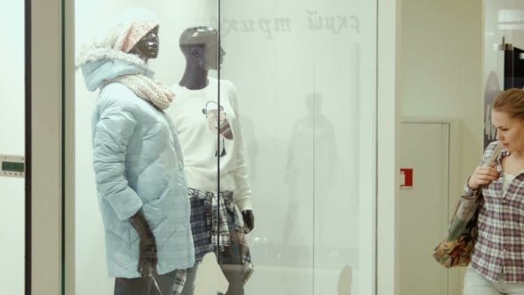 Thumbnail for The Girl Looks At a Show-window Of Clothing Store