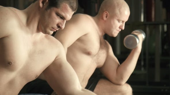 Thumbnail for Two Men Train In a Gym
