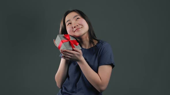 Thumbnail for Excited Asian Girl Received Gift Box. She Is Happy and Flattered By Attention