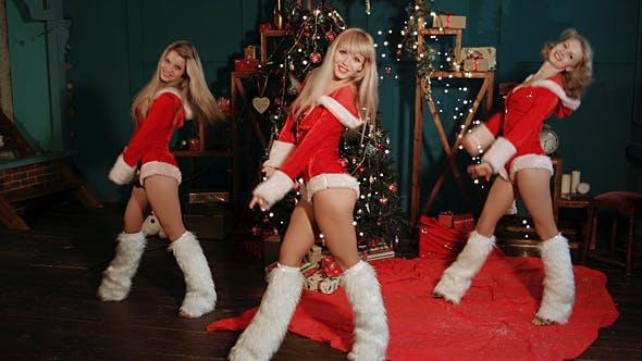 Thumbnail for Dancing Girls in Santa Claus Costumes