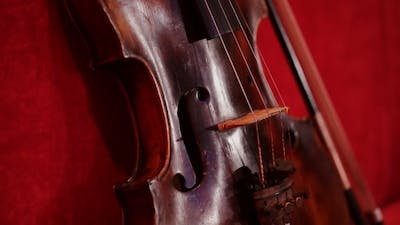 Violin On The Beautiful Red Background