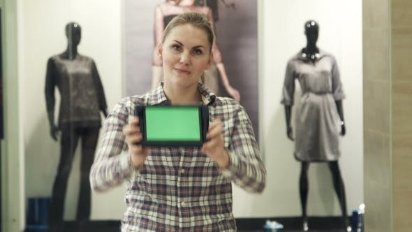 The Girl Shows The Tablet With The Green Screen