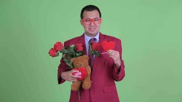 Cover Image for Sad Asian Businessman with Eyeglasses Depressed for Valentine's Day