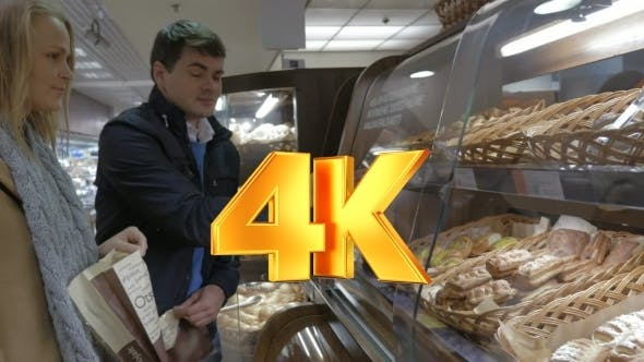 Thumbnail for Man And Woman Buying Delicious Bun In The Shop