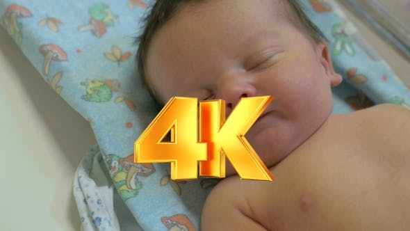 Thumbnail for A New-born Resting In Bed