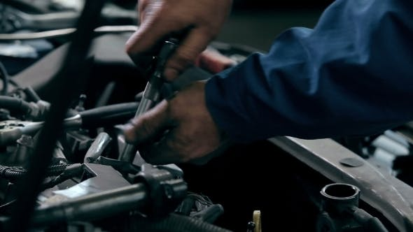 Thumbnail for Serviceman Repairing Car Engine