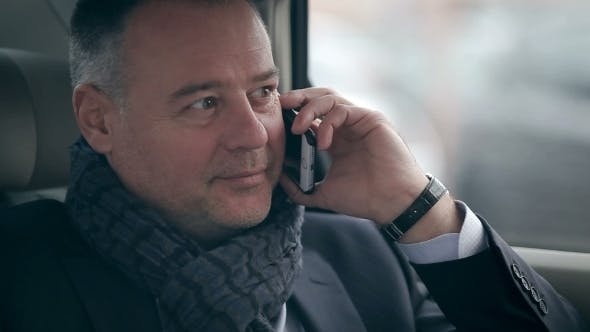 Thumbnail for Successful Businessman Answering The Call