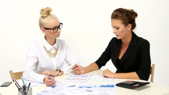 Thumbnail for Businesswomen Discussing One Diagram