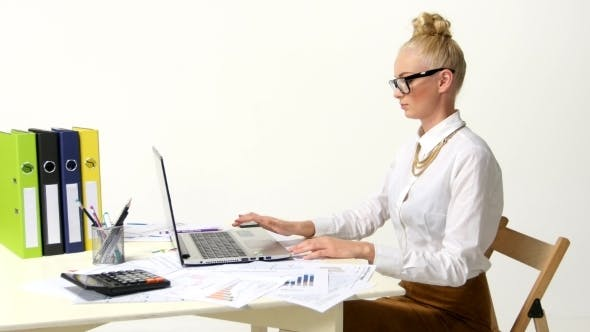 Thumbnail for Businesswoman Working In Office Using Laptop