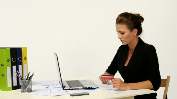Thumbnail for Businesswoman In Office And Paying