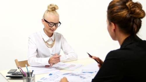 Businesswomen Discussing Diagrams