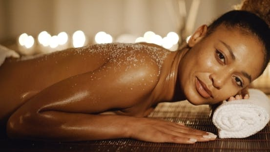 Thumbnail for Woman Lying On Massage Table With Salt Scrub