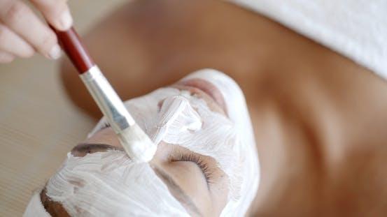 Thumbnail for Cosmetician Applying Facial Mask