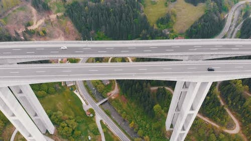 Aerial View of the Highway Viaduct on Concrete Pillars with Traffic in Mountains
