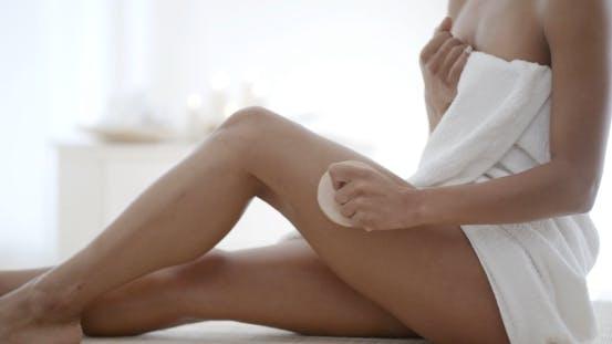 Thumbnail for Woman Massaging Leg In Spa