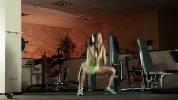 Cover Image for Woman Doing Sport Exercise Squats And Jumps