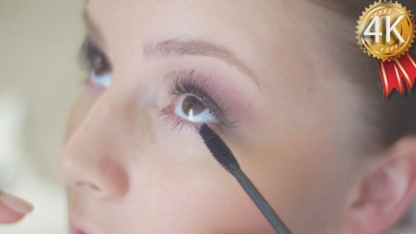 Thumbnail for Stylist is Putting On Black Mascara