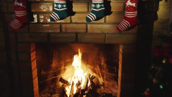 Thumbnail for Above The Fireplace Hangs a Burning Socks For